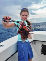 Lauren Arrington and lionfish.