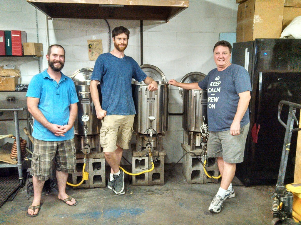 The very helpful Great Fermentation staff in front of their brew station.