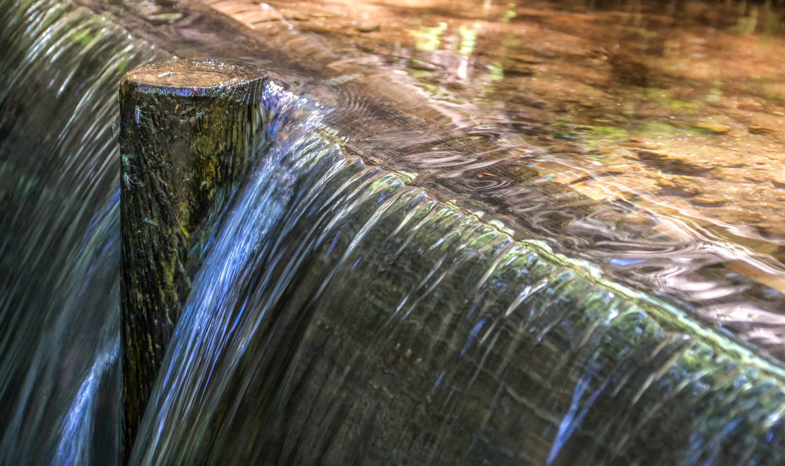 water breaking a dam